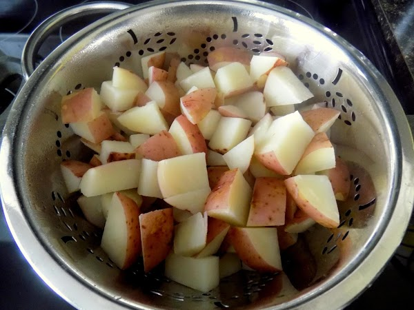 Cook potatoes in salted water until fork tender. Drain well. Place in large bowl...