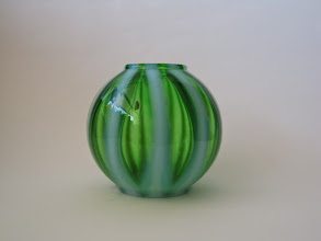 Photo: Fratelli Toso green glass fluted vase with opalescent white 'Lattimo' vertical ribbing.