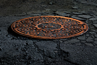 Photo: Manhole Cover at Night - Bell System