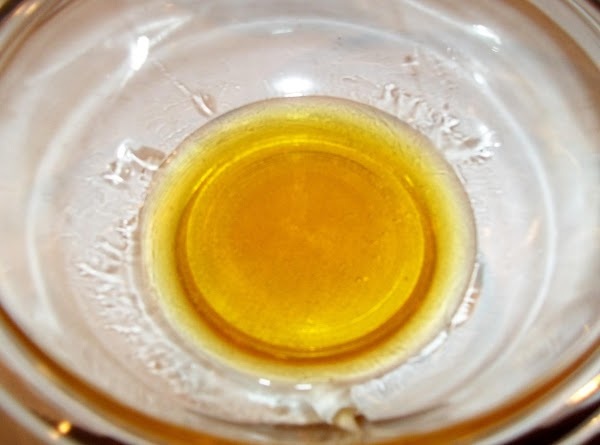 Combine honey and vinegar in a small bowl, stirring well.