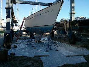 Photo: After last year's hull repairs, the boat yard informed us that any further bottom paint removal would require tenting the hull. Thus our bottom job began by laying out 6 mil plastic sheeting under Pilgrim.