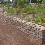 Red coloured modern dry stone wall