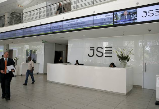 People walk near the reception at the Johannesburg Stock Exchange (JSE) in Sandton, Johannesburg. Picture: SIPHIWE SIBEKO / REUTERS