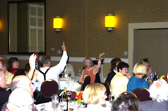 Photo: Anthonie & Dorothy Heffner Voogd raising hands, and Sue Mertz in yellow jacket