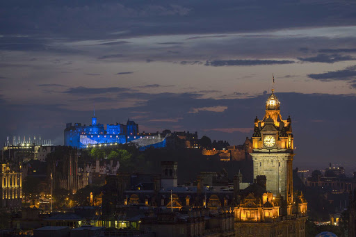An illuminated Edinburgh Castle during the Royal Edinburgh Military Tattoo event.