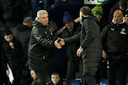 Newcastle United manager Steve Bruce (L) shakes hands with his West Bromwich Albion (R) counterpart Slaven Bilic at the end of the FC Cup match at the Hawthorns in West Bromwich, Britain,  March 3, 2020 before English football was halted by Covid-19.