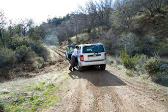 """Photo: The crappy 2WD """"Sports Utility Vehicle"""" was no match for a simple rut. We tried it a few times, but decided to abandon the endeavor after having a traction wheel stuck in the air for a few times."""