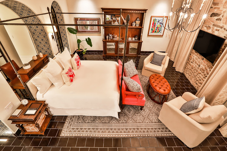 A colonial chic vibe infuses the guest rooms of the Rosewood Puebla.