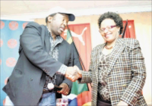 DEAL: Jomo Cosmos boss Jomo Sono with Vaal University of Technology vice chancellor Irene Moutlana during a press conference yesterday. Pic. Veli Nhlapo. 08/09/08. © Sowetan.