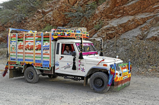 A colourful truck drives on a road in Rajasthan, India. Picture: 123RF/PIERRE-JEAN DURIEU