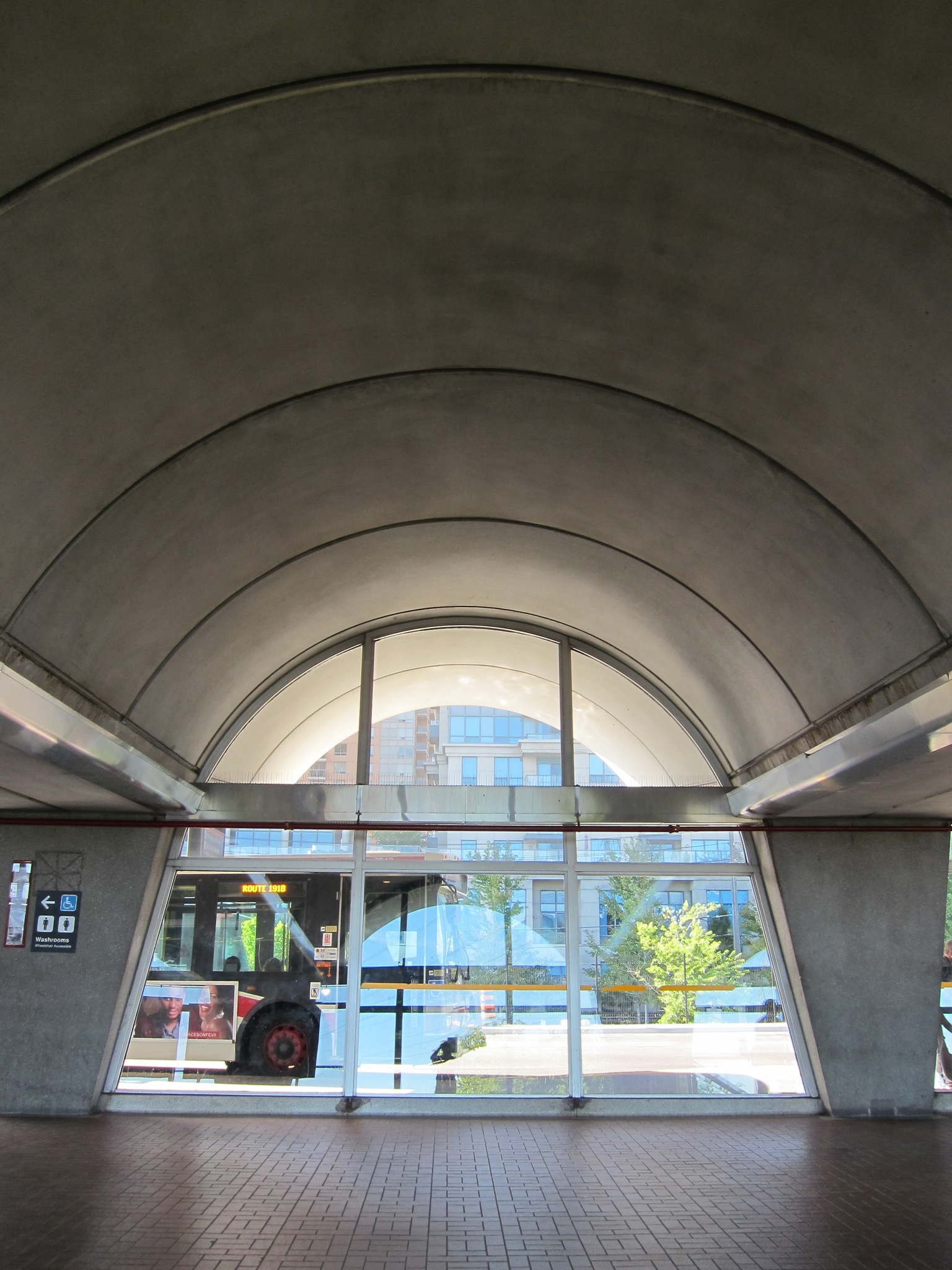 Photo: The arched roof of a bus bay.  This format extends across the width of the station, with twenty repeating arches in total, made of pre-cast concrete.