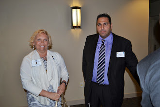 Photo: PDG Sue Poss and Greenville East president 2013-14 Edgar Francis.