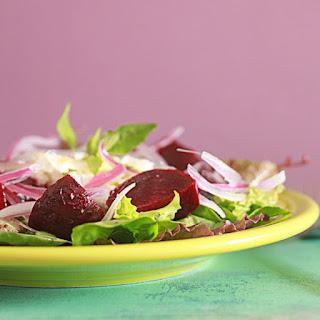 Roasted Beet, Red Onion, & Goat Cheese Salad with Honey-Oregano Vinaigrette.