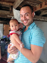 Photo: Russ Taufa (exSDL) with baby in Chomtong