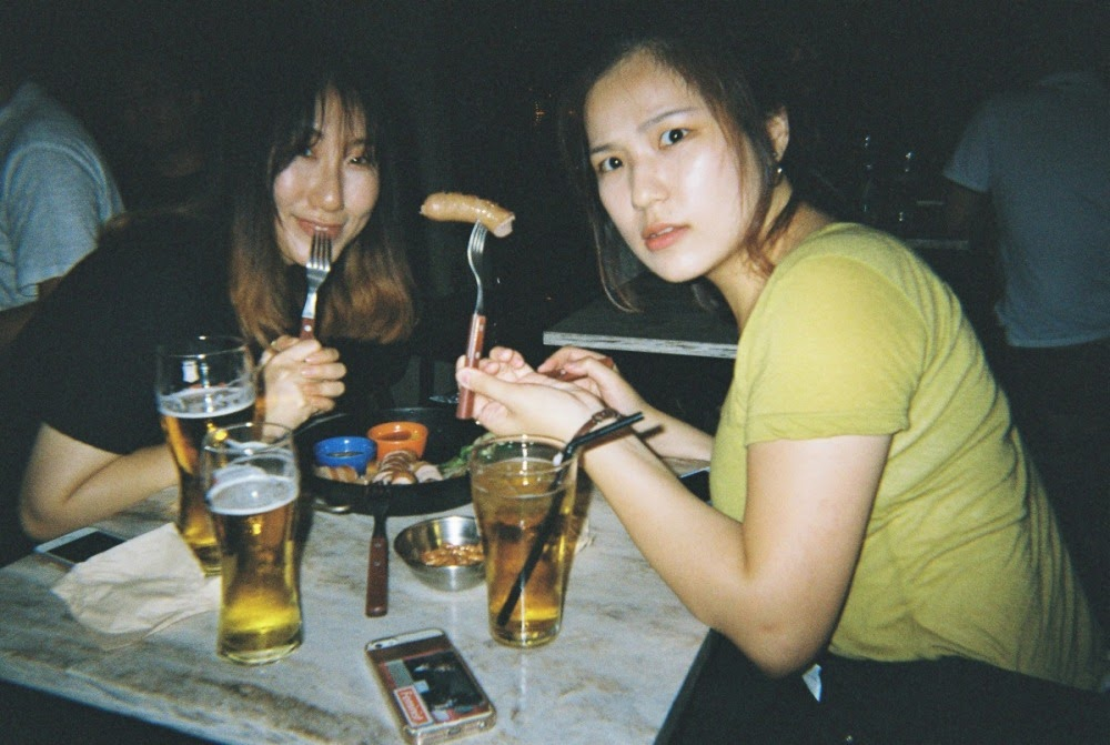 my 23rd bday in Itaewon. SJ and KY eating wurst.