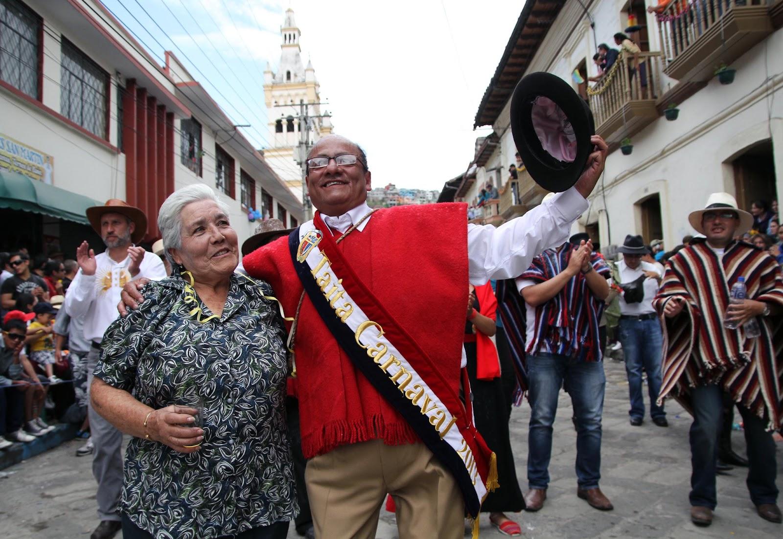 Taita Carnaval of Guaranda and an elderly grandma dancing with joy.