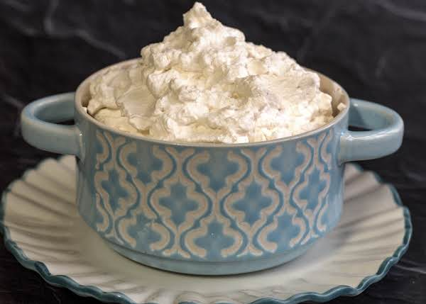 A Bowl Of Fluffy Whipped Cream.