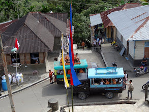 Photo: Public transportation on the island is these small trucks. The children in uniform are school children.