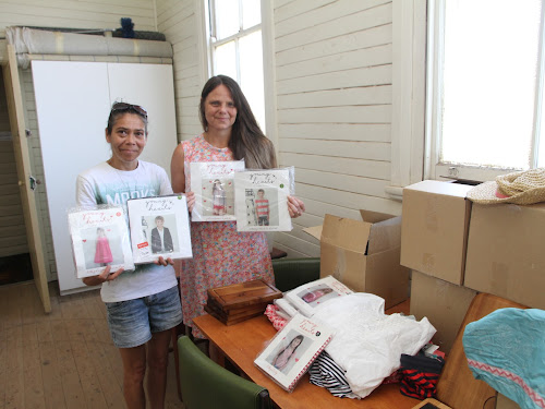 Brand new, donated Collette Dinnigan children's fashions - many of them - will be on sale at the garage sale at the Presbyterian Hall from 10am to 2pm on Saturday. Pictured are Sandra Gray and Carla Constance with the designer clothing.