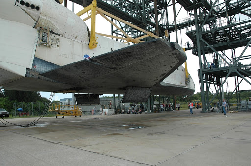 Atlantis is slowly lowered to the ground at the mate demate device at Kennedy Space Center's Shuttle Landing Facility.