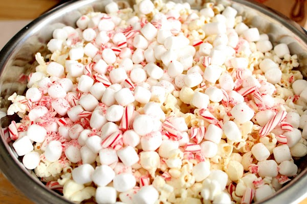 Layer the popcorn, candy canes and marshmallows in a large bowl or pot.