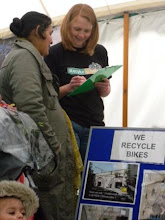 Photo: A day in the life of Recyke y'Bike at the Newcastle Green Festival June 2011. Dealing with enquiries on the stall. (Recyke y'Bike)