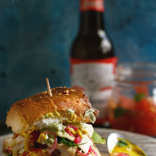 Pulled Malai Chicken Tikka Sliders with homemade pickle and salsa.