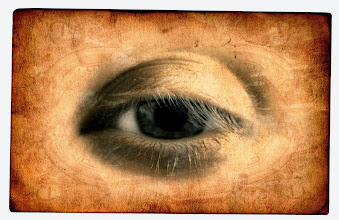 Photo: Grungy image of an eye printed on an old card.