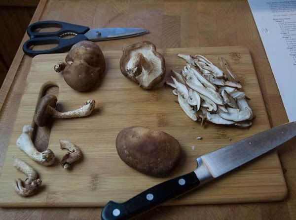 Shitake mushrooms have a thick woody stem, remove the stems, then julienne, and reserve...