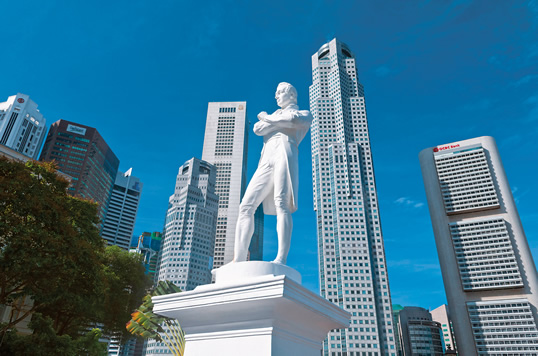 "This statue of Sir Thomas Stamford Raffles, framed by the skyscrapers of Raffles Place across the Singapore River, is believed to stand at the spot where he landed in 1819, going on to establish the British settlement on the island. ""He looked to the Arabs to bring this strategic location to life,"" says Syed Farid Alatas."