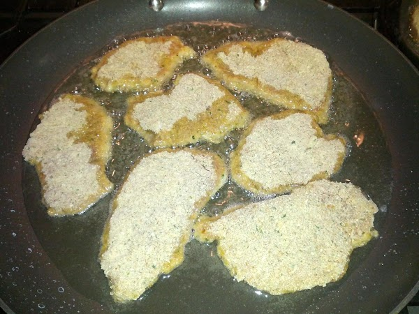 Place enough oil in a large pan to cover the bottom.  Heat oil...