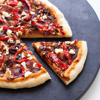 Hummus Pizza with Red Pepper and Caramelized Onions