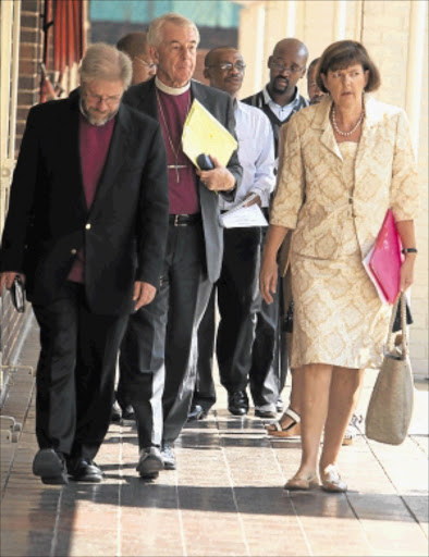 SERIOUS ISSUE: Reverend Paul Verryn , Bishop Peter Lee and Gauteng MEC for education Barbara Creecy attend the signing of the memorandum of understanding. It sets out the spirit and context of cooperation between Gauteng education department and faith-based organisations. PHOTO: ANTONIO MUCHAVE