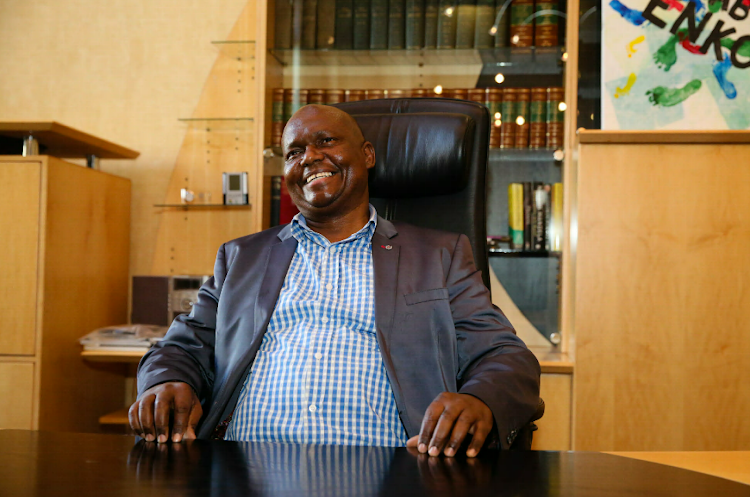 Mongameli Bobani gets comfortable in his new office at City Hall.