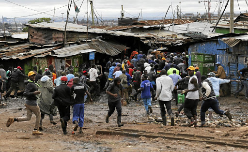 Protesters run as riot police attempt to disperse supporters of Kenyan opposition leader Raila Odinga, in Kibera slums of Nairobi, Kenya on October 26 2017. Picture: REUTERS