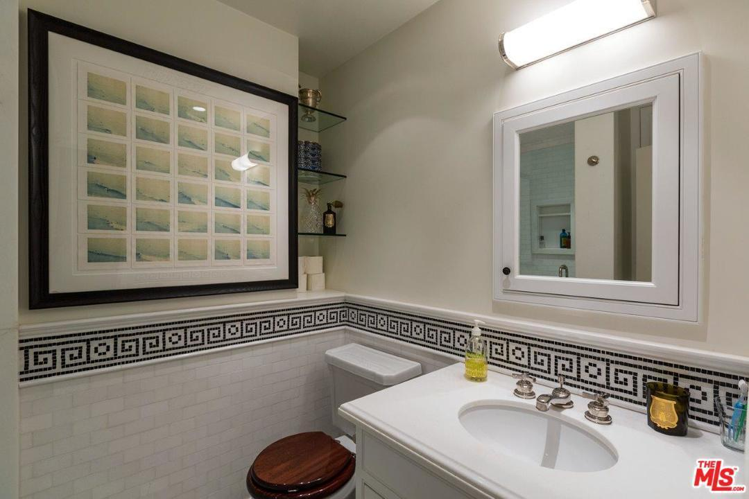 A Second Bathroom Repeats The Same Decor With A Wood Toilet Seat Love The Print Was Moved Here From The Living Room