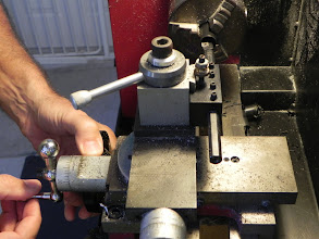 Photo: Here I am setting the boring bar to turn the ID of the head joint to receive the top hand joint. I try to make 20 or 30 whistles at a time because it is so tedious to set up the machines. It takes much longer than making the cut.