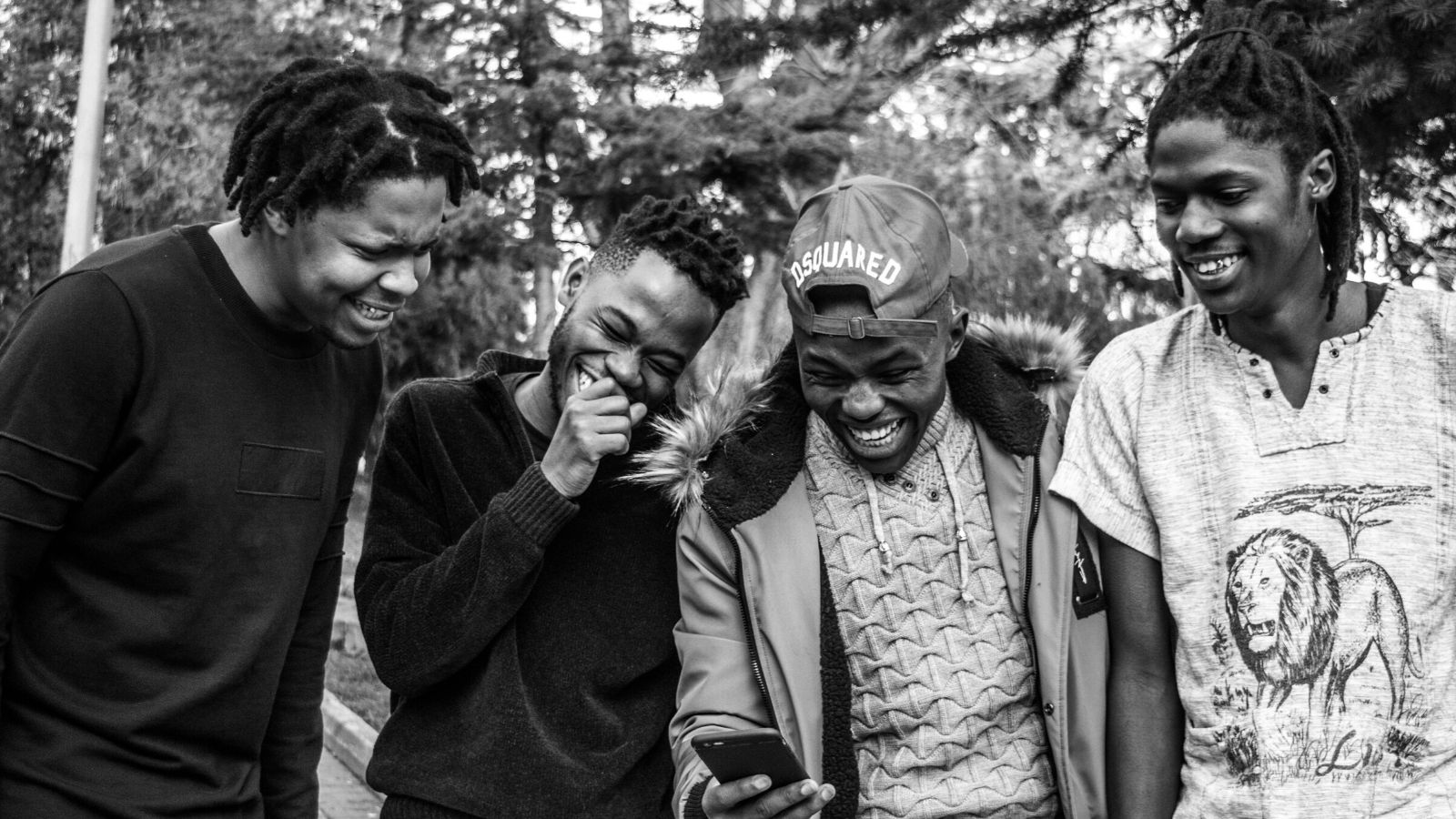 A group of African-American men sharing laughter.