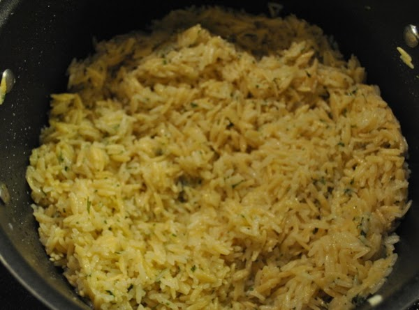 Slowly add in chicken stock. Stir. Cover and cook 20 minutes. Stirring occasionally. Add...