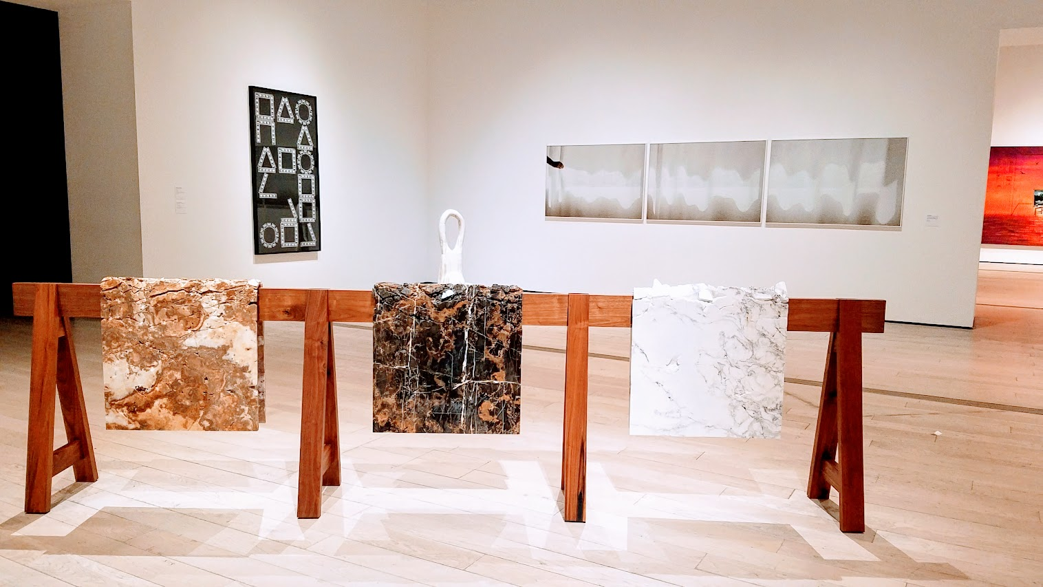 Draped Marble (Carrara, St. Laurant, Brown Onyx) by Analia Saban. Marble mounted on steel on wooden sawhorse. Displayed at Broad Contemporary Art Museum at LACMA