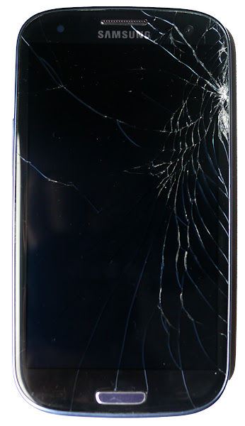 Photo: Samsung Galaxy S3 cracked screen. But how much to fix?  Here's my Samsung Galaxy S3, Spiderman special edition. Like it? Nope, me neither. I was somewhat surprised and upset to find the screen dramatically cracked following a fall of no more than two feet onto a gravel surface the other week. No, I wasn't using a screen guard or case. I'm normally very careful - or lucky - with portable tech, and believe it or not in a 20 year career of testing and owning products, I've never broken or damaged a single thing. Until now that is, and it's going to cost me.  Since the display below the glass surface still works fine, I naively thought all it would take is a simple switch of the glass plate and I'd be back in action, but it turns out the GS3, like many modern smartphones, has the glass plate bonded to the display itself. Yes, you might be able to work some DIY magic with a hairdryer, but the official repair involves replacing the entire display unit at a significant cost. For the GS3 I've been quoted around 180 GBP or 300 USD from small market stalls to the biggest shops.  As a side-note I was very disappointed to find Samsung's flagship showroom in London couldn't repair it in-store. Lest we forget Samsung was a major sponsor at the 2012 Olympics, and used the GS3 as its hero product during the event. The London showroom opened in Stratford, literally next to the entrance of the Olympic park and is styled inside in a similar aspirational way to Apple stores. This is the one place in the whole UK where any Galaxy problems should dissolve into solutions, but no. I was told I needed to schlep my S3 across London to Islington to a repair centre. I called the centre and they were very nice, but I didn't have time to make the detour at that point in my trip as I was flying out two days later. Ironically, a nearby Carphone Warehouse did offer in-store repairs, but had not yet been certified to touch the GS3.  Now don't get me wrong, I like Android and love the GS3. But this is one aspect where even die-hard drod-heads would have to admit the Apple experience is superior. As I understand it, pretty much any Apple store will either repair or replace a broken handset in-store. Depending on the circumstances, there may be charge, but I think it's less than I've been quoted for my GS3 repair. Ultimately I'm very envious of a broad infrastructure of stores which will not only sympathise with your problems, but also normally fix them, often while you wait. This has to be one of the best aspects of buying into the Apple world.  But even though I have two iPads and a MacBook Air, I still prefer the hardware - and the OS - of the GS3 for my phone. I just have to live with the inferior service when things go wrong. Which brings me to my current predicament. I've got this top-end phone with a horrible crack which taunts me every time I look at it. The repair is prohibitively expensive. Then there's newer versions of the handset which support various 4G LTE bands. It's almost tempting to forget the repair and get a 4G model instead.  But this in turn brings me to another issue: exactly which variant of the GS3 is the best one for worldwide 4G compatibility - or at least compatibility in the UK and US. However much we strive for international radio standards, the fact is the local spectrum is chopped up and sold in so many different ways that it's almost impossible to find a phone which supports the latest data speeds everywhere.  So here's my question for the phone techies out there. Do you know the bands for 3G and 4G LTE in your country, and which ones are used by major operators? In the UK I believe the 4G frequencies are 800, 1800 and 2600MHz, but in the US I think it might be 700 and 1700MHz which are most common. There are 4G LTE variants of the GS3, but as far as I know, none which support all of those frequencies. I think T-Mobile USA may also use 1700MHz for some of its 3G which means many international handsets may be limited to 2G speeds on its network.  I'm confused, and my Spiderman special edition GS3 isn't making things any better. I'm now in the US for three months. Do I fix the screen? Do I buy a 4G LTE version that works here but might not back in the UK? Is it actually cheaper to enter into a contract than buy another unlocked handset given I may return to the US within 12 months? Do I try and find one phone which does it all? Or do I suck it up and let the cracked screen continue to teach me a lesson to be more careful? Put it this way, if I do get a new phone, I'm definitely getting a screen protector for it, and I'd recommend you do too. A cracked screen is a common breakage and one that on a modern smartphone is a very expensive repair.  PS - another point worth noting is that as we demand - or desire - ever thinner and good-looking tech with big displays, the more the manufacturers rely on bonded components. This may be fine when things are working well, but means if you break a small part, you may need to replace a significant portion at significant cost. Is this really the way forward for our phones, tablets and laptops?  (+Robert Scoble what do you think?)