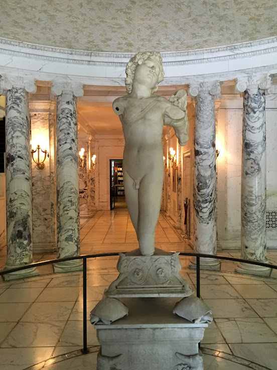 """Young Archer"" greets visitors in the marble foyer."