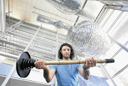 INGENIOUS: Massoud Hassani holds one of the many poles which are attached to a ball to form the mine sweeper he designed Picture: RUVAN BOSHOFF