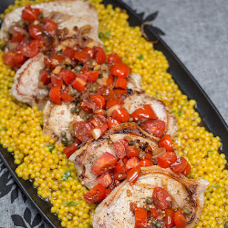 Pork Chops and Couscous with Tomato-Caper Sauce.
