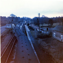 Photo: Sunday engineering work: a down train setting back over the crossover to the up line (1971)