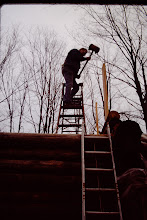 Photo: Fred driving splines in gable end logs.