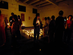 Photo: Over 2000 oil lamps and candles are lit. The people watch the flickering flames while listening to Tibetan mantric music.