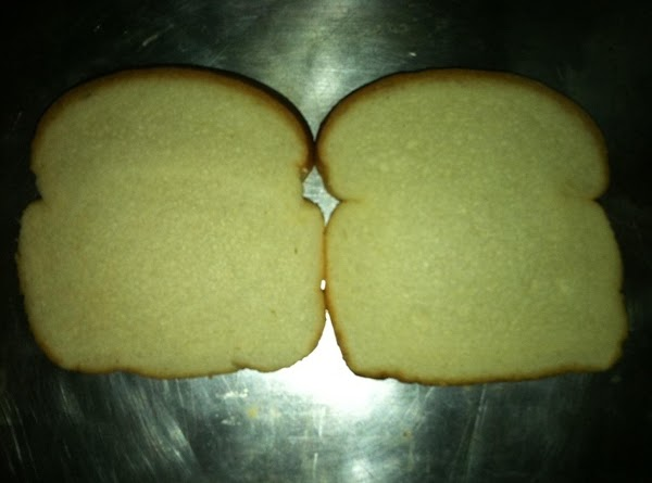 Toast the bread slices.  Place them on a baking sheet.