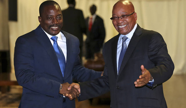 Joseph Kabila with South Africa's President Jacob Zuma. Picture: REUTERS