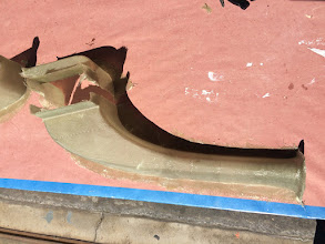 Photo: Oil cooler ducts popped from the molds, but not trimmed or halves bonded.